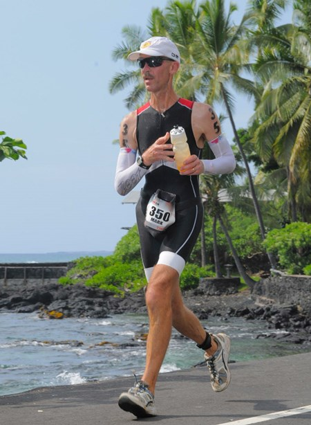 An avid athlete, Dr. Baker (seen here completing the running portion of an IronMan triathlon) has learned the importance of proper hydration through trial and error.
