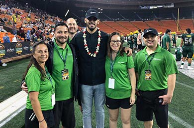 Straub Bone and Joint Team and Marcus Mariota standing in the Aloha Stadium