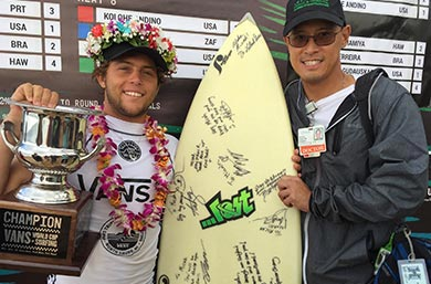 Dr. Spencer Chang and 2017 Vans World Cup Champion Conner Coffin holding a surfboard and a trophy