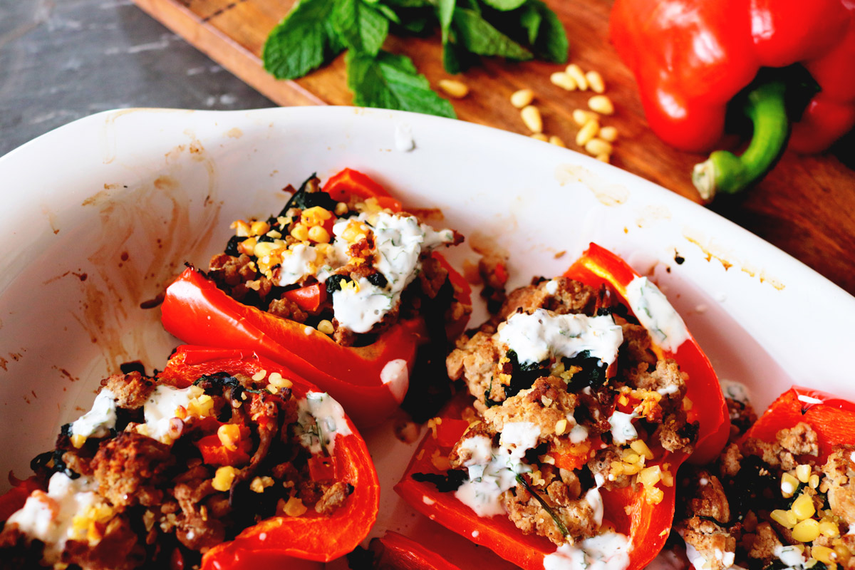 Masala Stuffed Peppers in a ceramic baking dish fresh out of the oven
