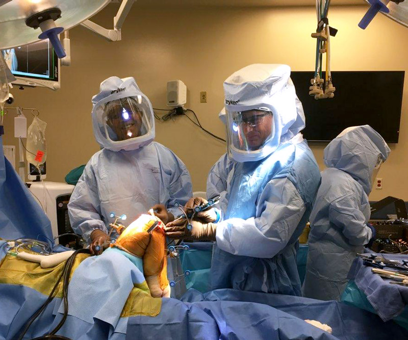 Dr. David Rovinksy and Dr. Erik Zeegen perform robotic-assisted total knee replacement surgery on cadavers.