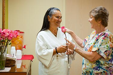 Patient at Pali Momi Medical Center given a rose by her nurse