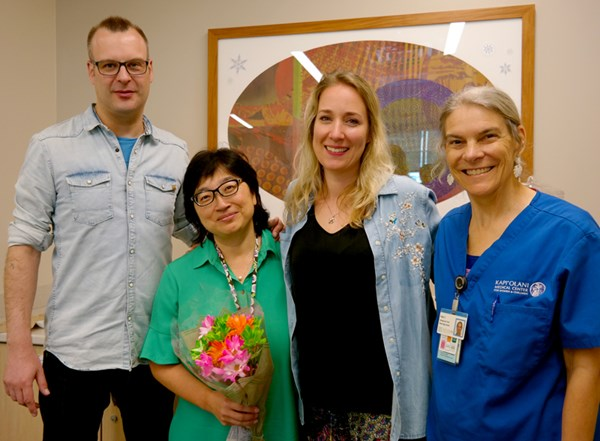 Olli and Sinah paid a special visit to Dr. Men-Jean Lee (second from left) and Patty Clayton (right) during their one-year anniversary trip back to Hawaii.