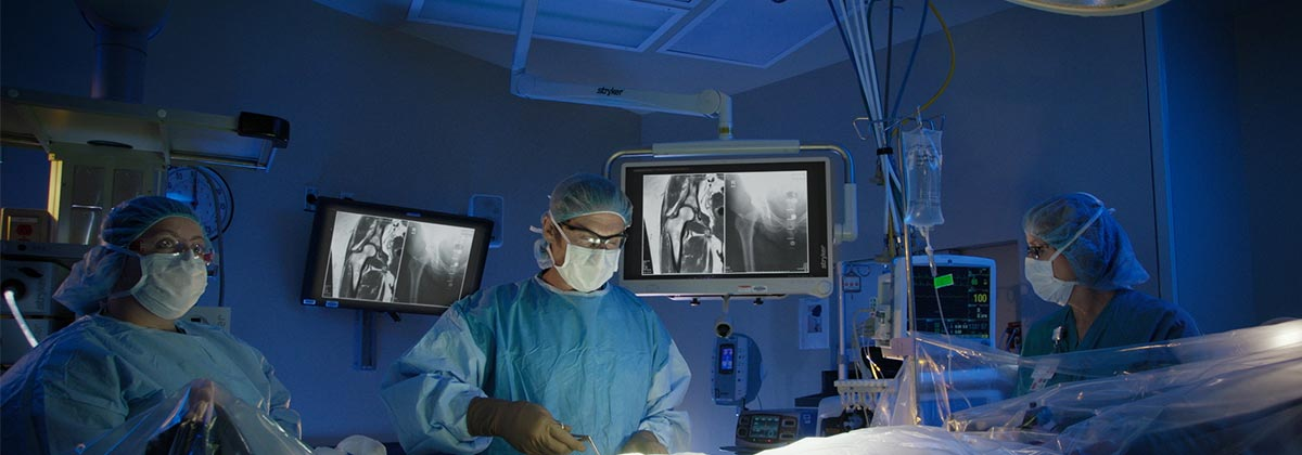 Bone and Joint Team Performing Surgical Operation in Modern Operating Room