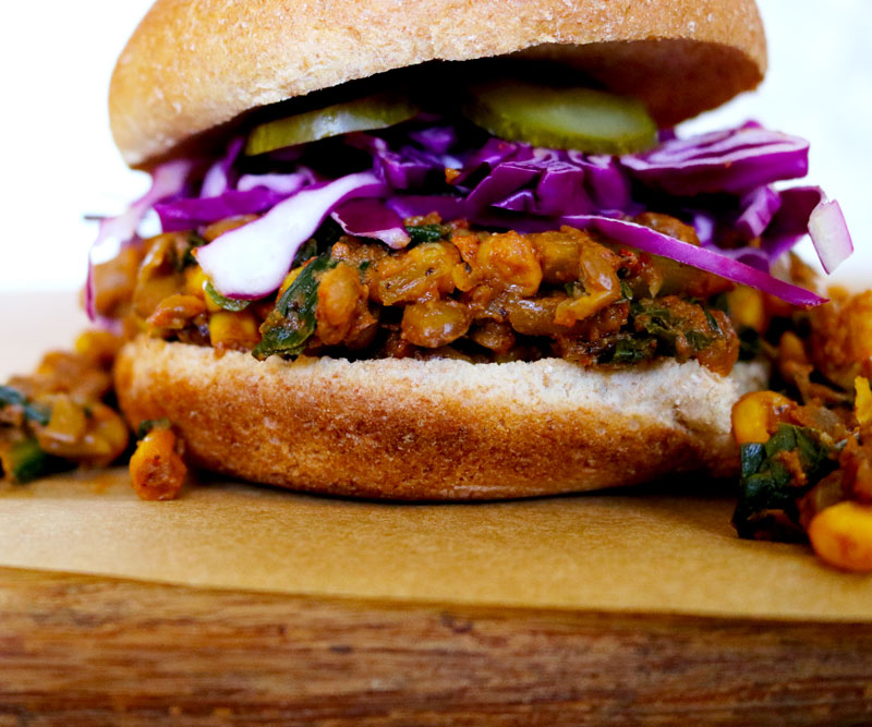 A very sloppily made Lentil Sloppy Joe topped with purple cabbage and pickles