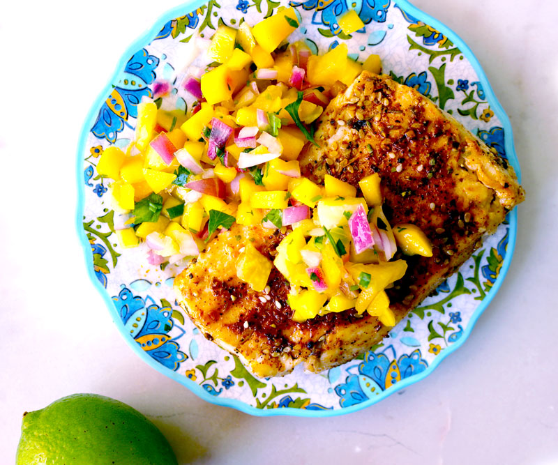 A colorful plate of Cajun-Spiced Mahimahi with Mango Pineapple Salsa