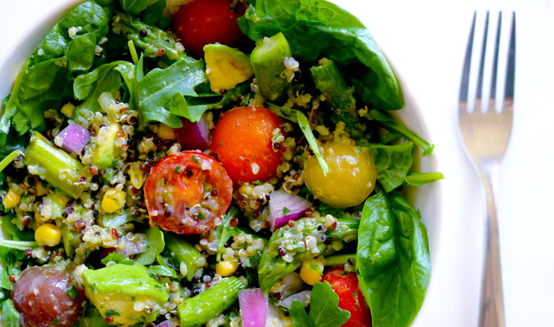 A bowl filled to the brim with Quinoa Salad with Summer Vegetables