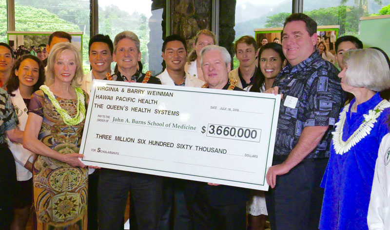 Hawaii Pacific Health President & CEO Ray Vara helps present a check for $3.66 million made out to the University of the University of Hawaii John A. Burns School of Medicine