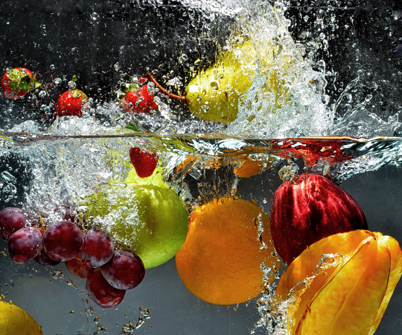 fruit being dropped into water